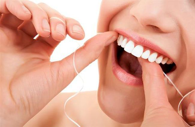 Report says flossing your teeth is pointless